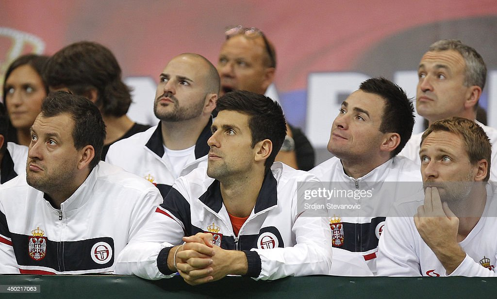 Novak Djokovic (C) watches the men's singles match between Dusan Lajovic of Serbia and Radek Stepanek of Czech Republic on day three of the Davis Cup World Group Final between Serbia and Czech Republic at Kombank Arena on November 17, 2013 in Belgrade, Serbia.