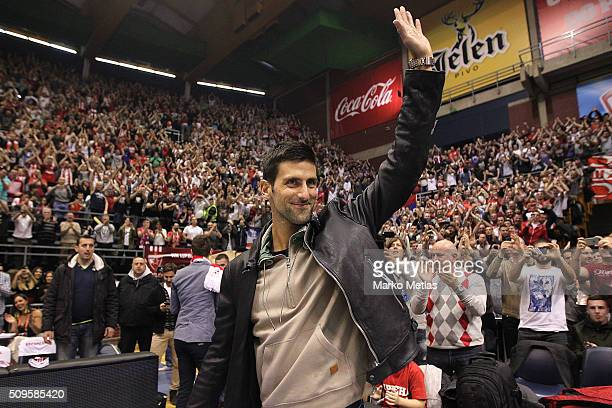 Novak Djokovic waves to the audience during the Turkish Airlines Euroleague Basketball Top 16 Round 7 game between Crvena Zvezda Telekom Belgrade v...