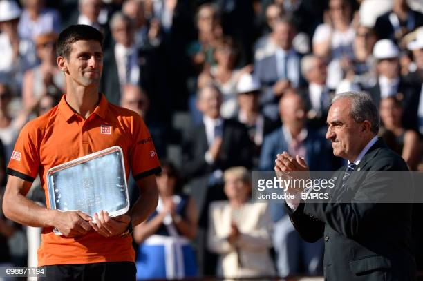 Novak Djokovic with his runners up plate after the men's singles final on day fifteen of the French Open at Roland Garros on June 7th 2015 in Paris...