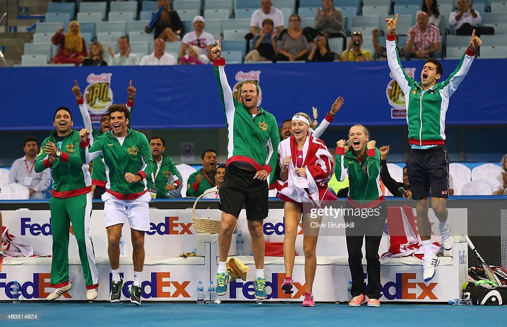 Novak Djokovic,Caroline Wozniacki,Kristina Mladenovic,John Leffine De Jager and the team bench of the UAE Royals all celebrate as team mates Nenad Zimonjic and Marin Cilic win the tie break shoot out against the Manila Mavericks during the Coca-Cola International Premier Tennis League fourth leg at the Hamdan Sports Complex, December 11, 2014 in Dubai.