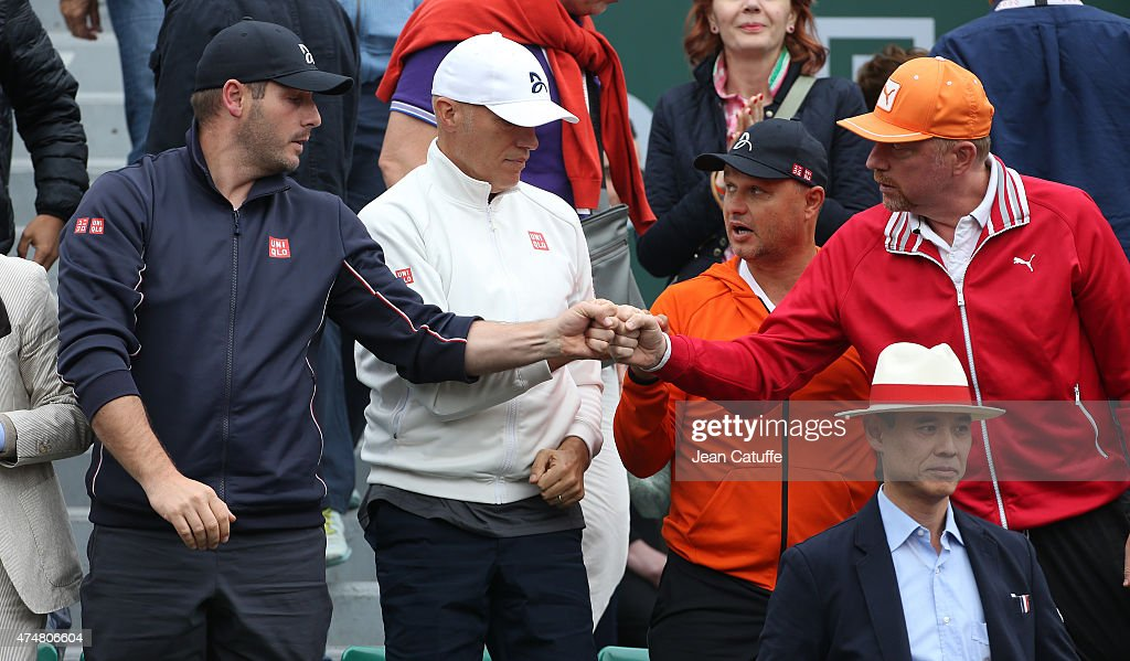 Novak Djokovic's team, physiotherapist Milan Amanovic, physical trainer Gebhard Phil-Gritsch, coaches Marian Vajda and <a gi-track='captionPersonalityLinkClicked' href=/galleries/search?phrase=Boris+Becker&family=editorial&specificpeople=67204 ng-click='$event.stopPropagation()'>Boris Becker</a> greet each other after Novak's victory during day 3 of the French Open 2015 at Roland Garros stadium on May 26, 2015 in Paris, France.