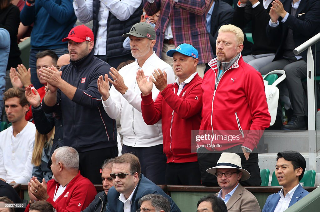 Novak Djokovic's team, physiotherapist Milan Amanovic, physical trainer Gebhard Phil-Gritsch, coaches Marian Vajda and <a gi-track='captionPersonalityLinkClicked' href=/galleries/search?phrase=Boris+Becker&family=editorial&specificpeople=67204 ng-click='$event.stopPropagation()'>Boris Becker</a> react during the Men's Singles final match on day fifteen of the 2016 French Open at Roland-Garros stadium on June 5, 2016 in Paris, France.