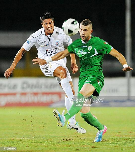 Novara's Romano Perticone vies with Avellino's Andrey Galabinov during an Italian Serie B football match AS Avellino vs Novara at the...
