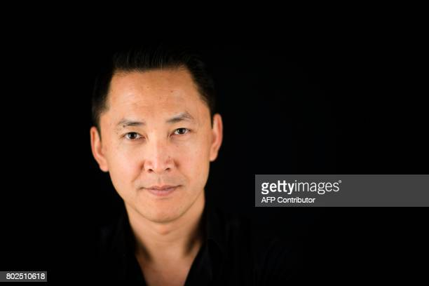 US novelist 2016 Pulitzer prize winner for Fiction vietnameseborn Viet Thanh Nguyen poses during a photo session on June 28 2017 in Paris / AFP PHOTO...