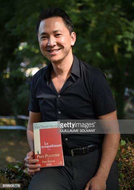 US novelist 2016 Pulitzer prize winner for Fiction vietnameseborn Viet Thanh Nguyen poses during the 22th La Foret Des Livres book fair on August 27...