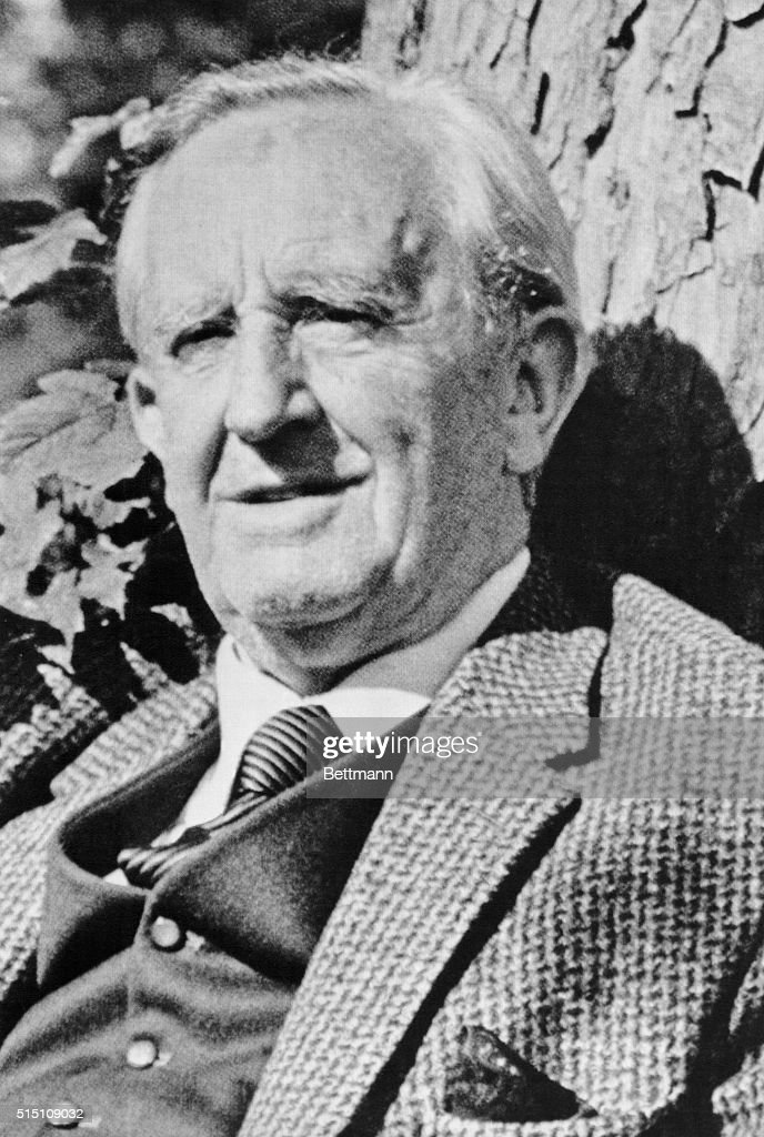Novelist and professor <a gi-track='captionPersonalityLinkClicked' href=/galleries/search?phrase=J.R.R.+Tolkien&family=editorial&specificpeople=1502445 ng-click='$event.stopPropagation()'>J.R.R. Tolkien</a> sits against a tree. He was the author of The Lord of the Rings and The Hobbit.