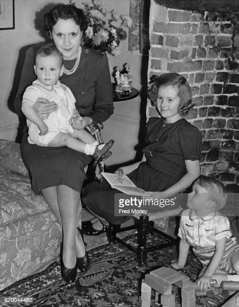 Novelist Barbara Cartland with her three children Glen Raine and Ian 16th December 1940 They have returned from Canada and are living in Bedfordshire...