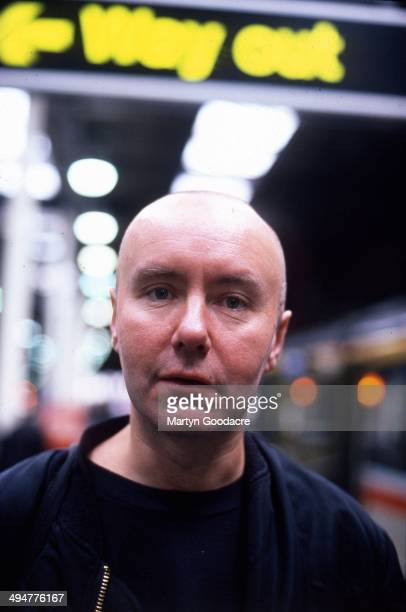 Novelist Irvine Welsh portrait at a railway station in London United Kingdom 1995