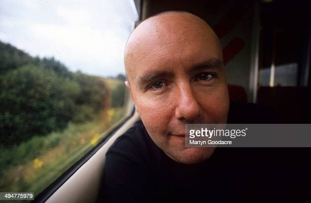 Novelist Irvine Welsh portrait on a train United Kingdom 1995