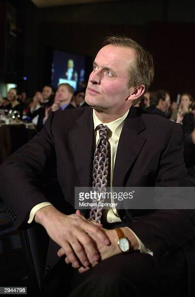 Novelist John Grisham listens to a speaker during the annual Virginia Democratic Party's JeffersonJackson Day Dinner February 7 2004 in RIchmond...