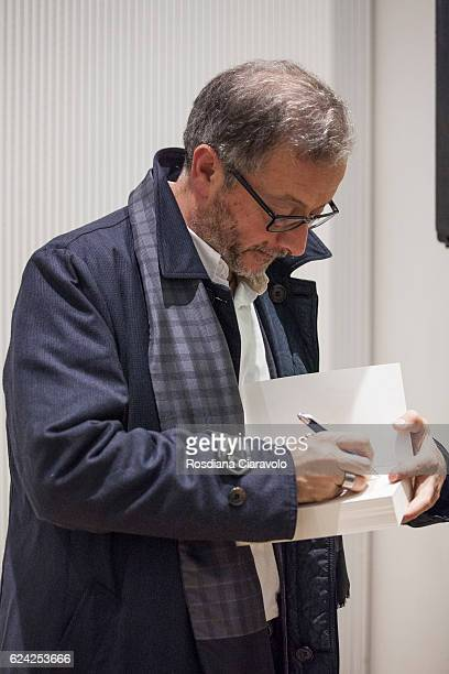 Novelist Journalist and screenwriter Diego De Silva signs a copy of his book during the Bookcity Milan 2016 on November 18 2016 in Milan Italy