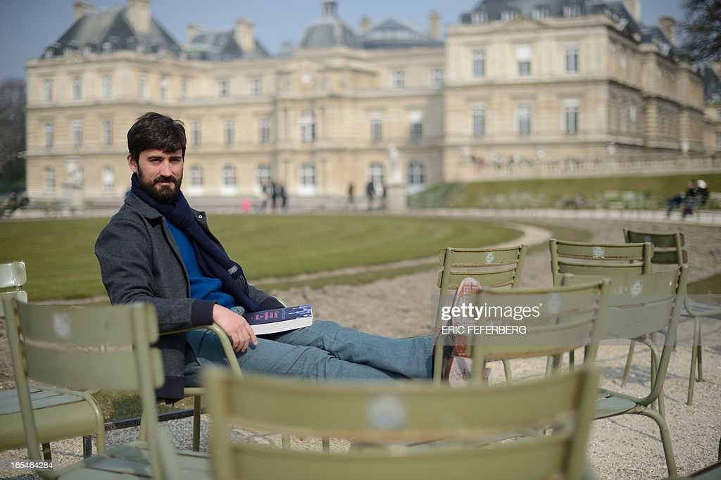 US novelist Scott Hutchins poses at the Luxembourg garden on April 4, 2013 in Paris. AFP PHOTO ERIC FEFERBERG