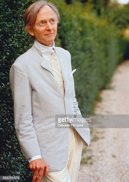 Novelist Tom Wolfe Standing by Hedge