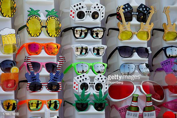 Novelty sunglasses are displayed for sale at Venice Beach in Los Angeles California US on Wednesday Aug 14 2013 Overall US tourismrelated sales...