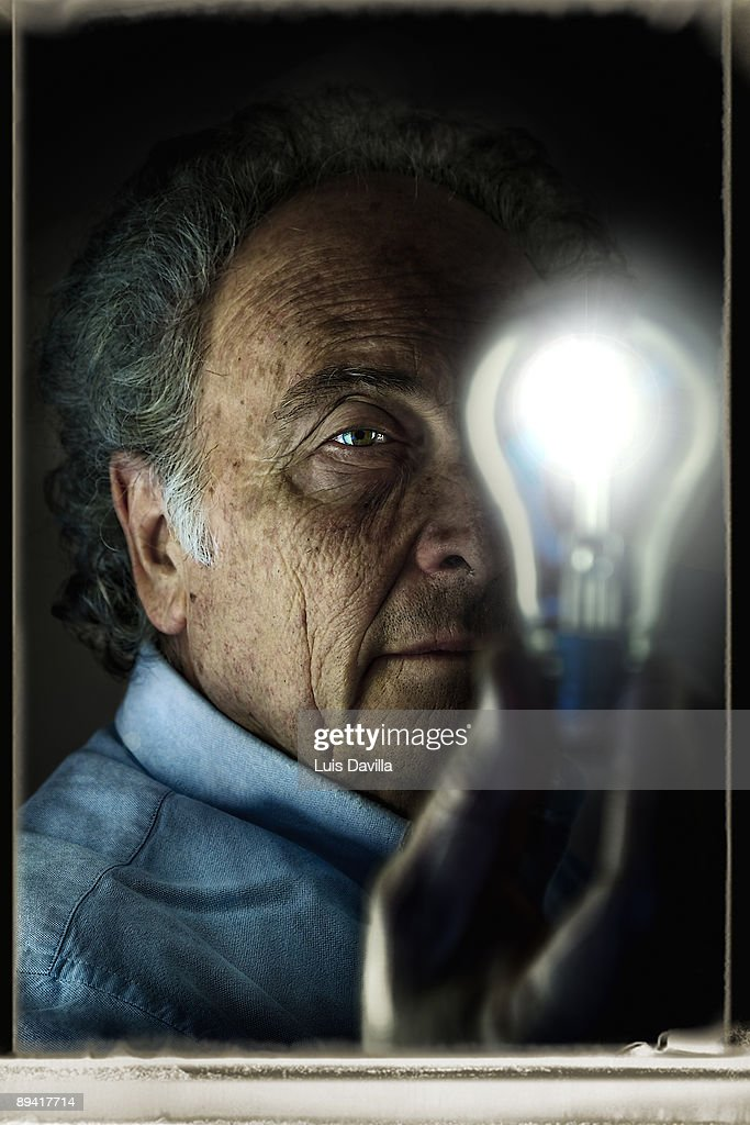 November 08, 2007. Barcelona, Catalonia, Spain. In the image, In the image, the writer and scientific, Eduardo Punset, with a lightbulb in his hand.