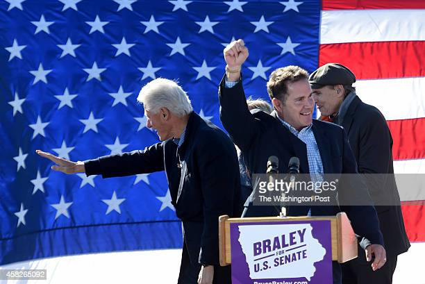 Former President Bill Clinton and US Senate candidate Rep Bruce Braley take the stage after being introduced by singer James Taylor and his wife Kim...