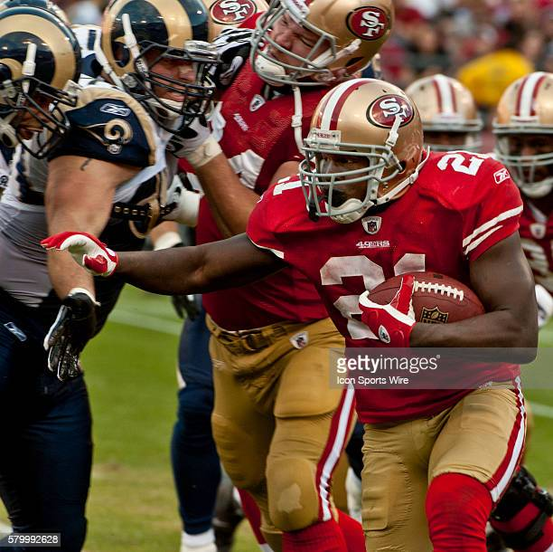San Francisco 49ers running back Frank Gore runs by Rams defenders on Sunday November 14 2010 at Candlestick Park in San Francisco California The...