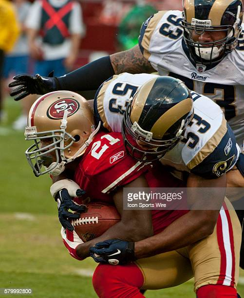 St Louis Rams linebacker Na'il Diggs pulls down San Francisco 49ers running back Frank Gore on Sunday November 14 2010 at Candlestick Park in San...