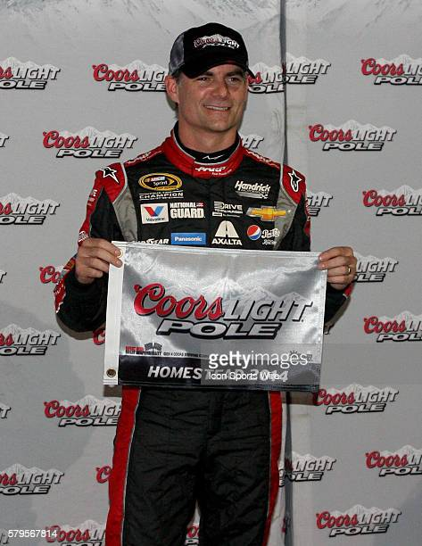 Jeff Gordon driver of the No24 Drive to End Hunger Chevy celebrates winning the pole for the NASCAR Sprint Cup Series Ford EcoBoost 400 at Homestead...