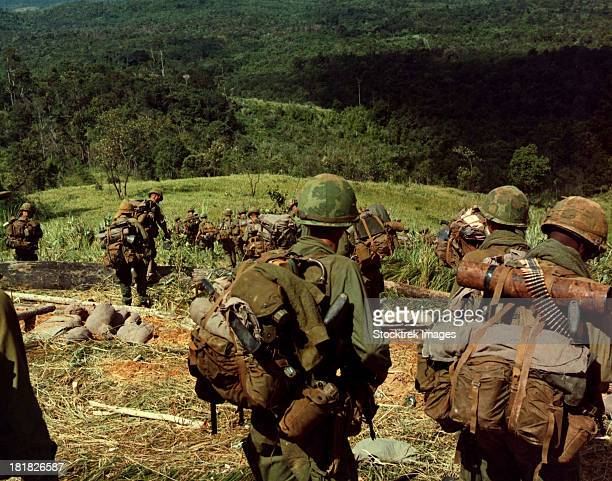 November 14-17, 1967 - Soldiers descend the side of Hill 742, located five miles northwest of Dak To, Vietnam.
