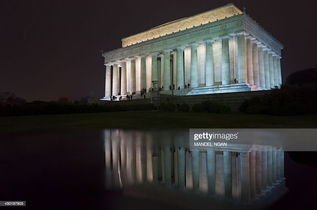 A November 16, 2013 photo shows the Lincoln Memorial, with its reflection on the top of a sign post, on the National Mall in Washington, DC. The nation will mark the 150th anniversary of Abraham Lincoln's famous Gettysburg address delivered during the American Civil War on November 19. AFP PHOTO/Mandel NGAN