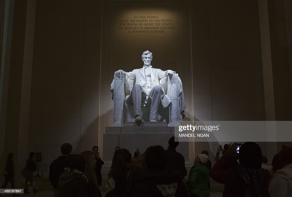 A November 16, 2013 photo shows the statue of Abraham Lincoln inside the Lincoln Memorial on the National Mall in Washington, DC. The nation will mark the 150th anniversary of Abraham Lincoln's famous Gettysburg address delivered during the American Civil War on November 19. AFP PHOTO/Mandel NGAN