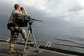 November 17, 2006 - Seaman scans the ocean during his security watch aboard USNS Supply (T-AOE-6).