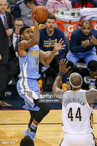 Denver Nuggets guard Gary Harris shoots over New Orleans Pelicans forward Dante Cunningham during the game between the New Orleans Pelicans and the...