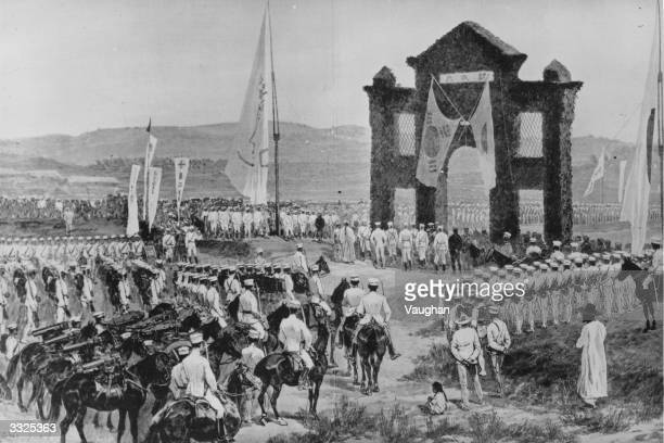 Japanese army passing the Triumphal Arch erected near Seoul Korea after the victory at Asan during the SinoJapanese War
