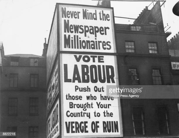 A street poster encouraging people to vote for the Labour Party 'Never Mind The Newspaper Millionaires Vote Labour Push Out Those Who Have Brought...