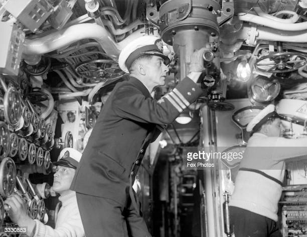 A crew member surveying the area through the periscope of the Chilean submarine 'O'Brien'