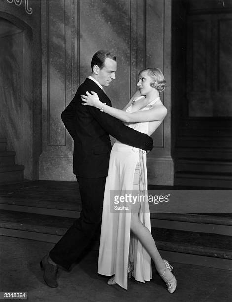Fred Astaire and Claire Luce perform the dance number 'Night and Day' in the musical comedy 'Gay Divorce' at the Palace Theatre London Music by Cole...
