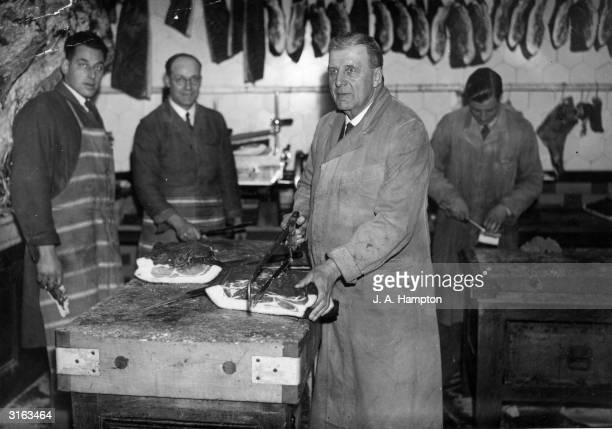 Mr J E Cottrell and staff carving up the produce in his butchers shop in Berkshire