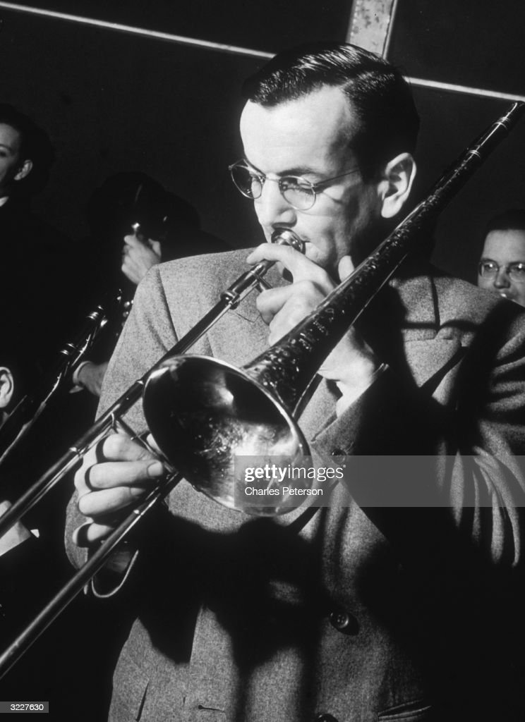 American musician and bandleader <a gi-track='captionPersonalityLinkClicked' href=/galleries/search?phrase=Glenn+Miller+-+Musician&family=editorial&specificpeople=12733485 ng-click='$event.stopPropagation()'>Glenn Miller</a> (1904 - 1944) plays trombone with his orchestra at the Meadowbrook Ballroom in Cedar Grove, New Jersey.