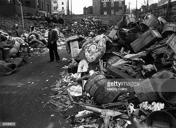 A once vacant lot in the center of town is filled with scrap after a fundraising drive in Lancaster Pennsylvania World War II