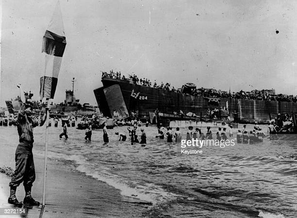 Landing Craft of the US army being guided into the beach at Leyte Island in the Philippines They are bringing more supplies to counter the Japanese...