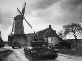 Polish armoured forces in Britishmade A27M Cromwell Cruiser tanks pass through typical Dutch countryside close to the front line at HoogeZwaluwe in...