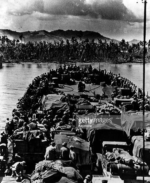 US troops packed into landing craft approach the shores of Leyte Island in the Philippines