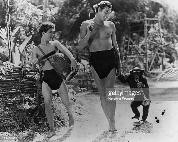 American actor and Olympic swimmer Johnny Weissmuller as Tarzan with Johnny Sheffield as Boy and the chimpanzee Cheetah