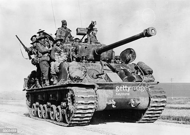 A tank laden with Australian soldiers 50 miles north of P'yongyang during the Korean war