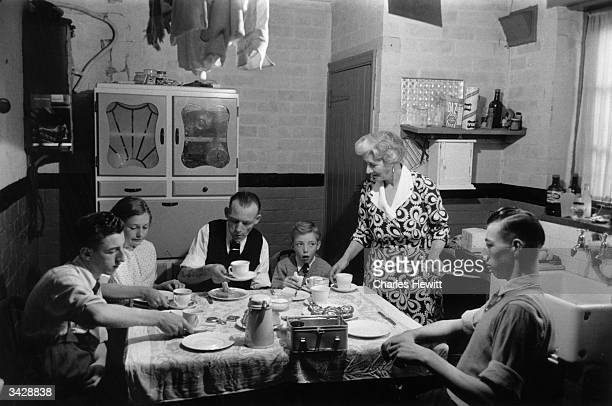 The Archer family having a meal together Mr Archer a widower with three sons visited a marriage bureau to find his second wife Original Publication...