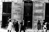 November 1956 Budapest rebels assault the building behind the tank The attack is a success and a standard bearer announces that the building is...