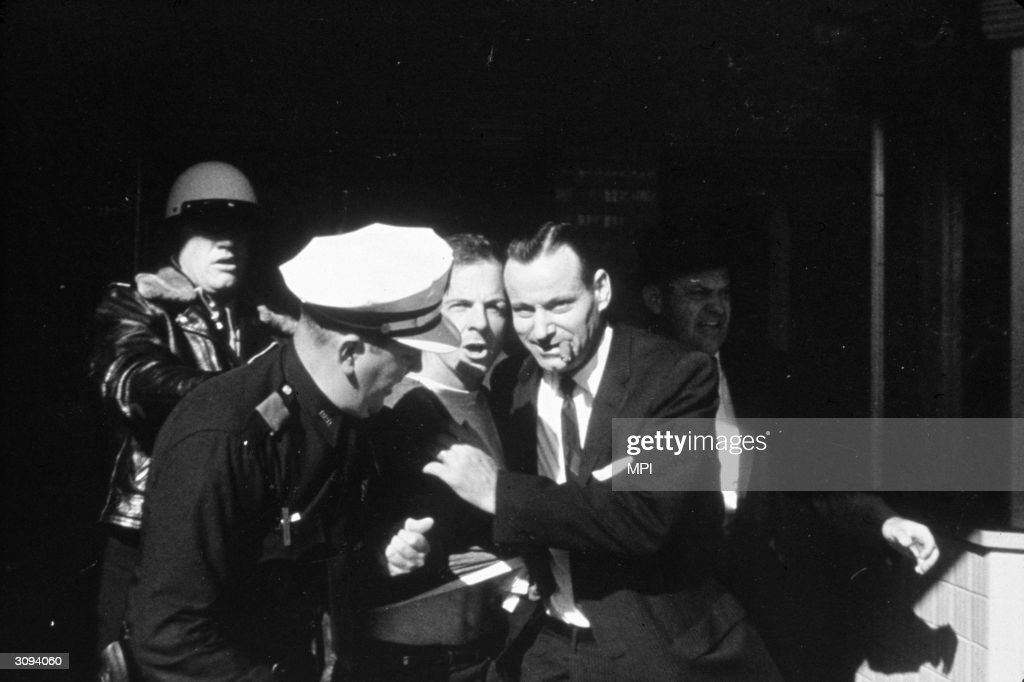 The arrest of Lee Harvey Oswald (1939 - 1963) for the assassination of President Kennedy in Dallas.