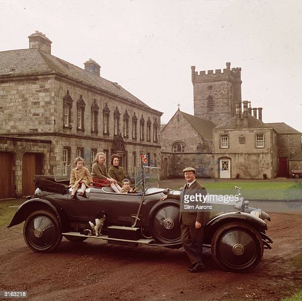 Lord Bruce and family in their vintage Rolls Royce at their Edinburgh home The family dog is taking a ride on the running board
