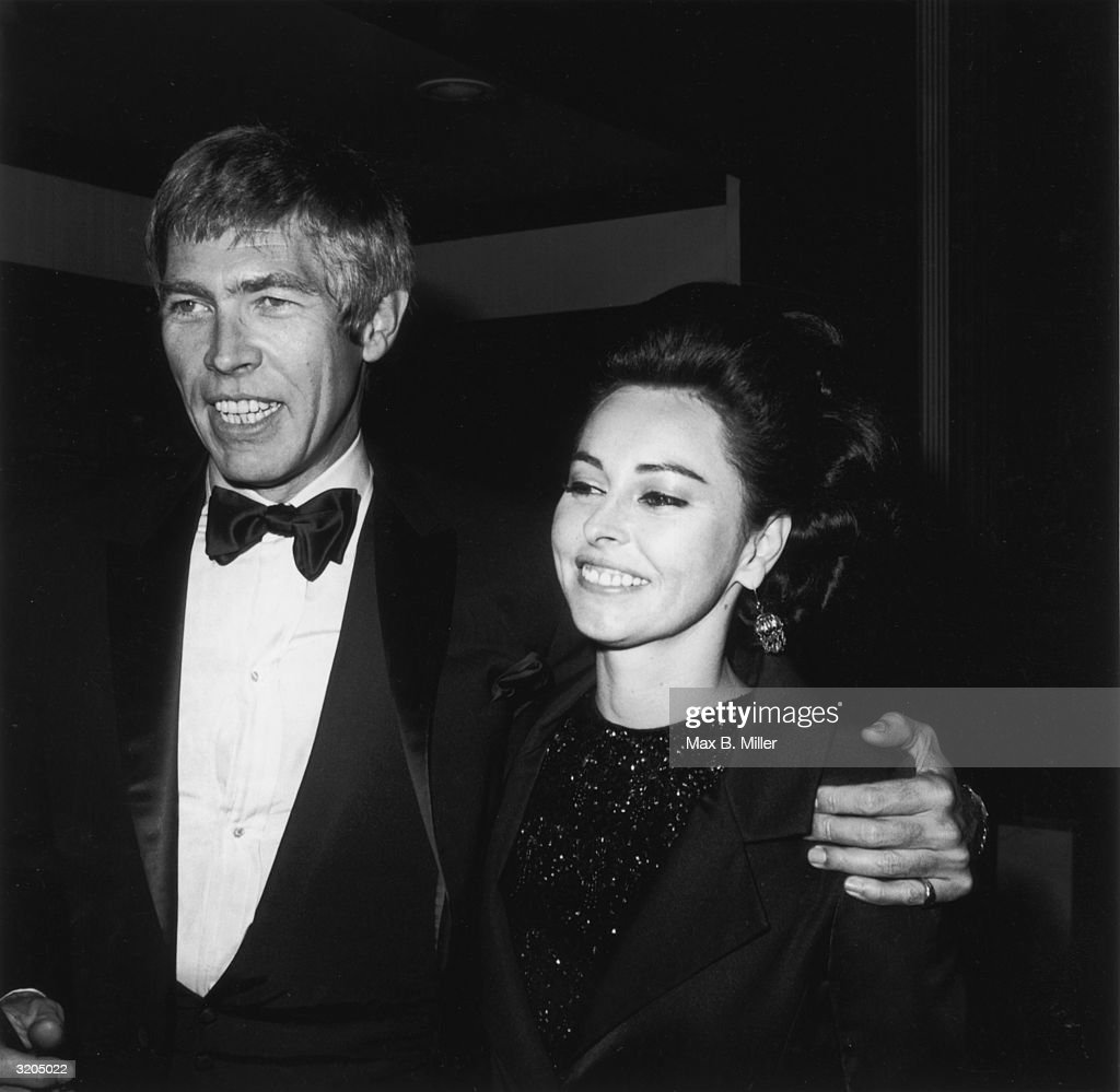 American actor James Coburn (1928 - 2002) and his wife, Beverly Kelly, attend the Stuntman's Ball. Coburn and his wife are smiling with their arms around each other.