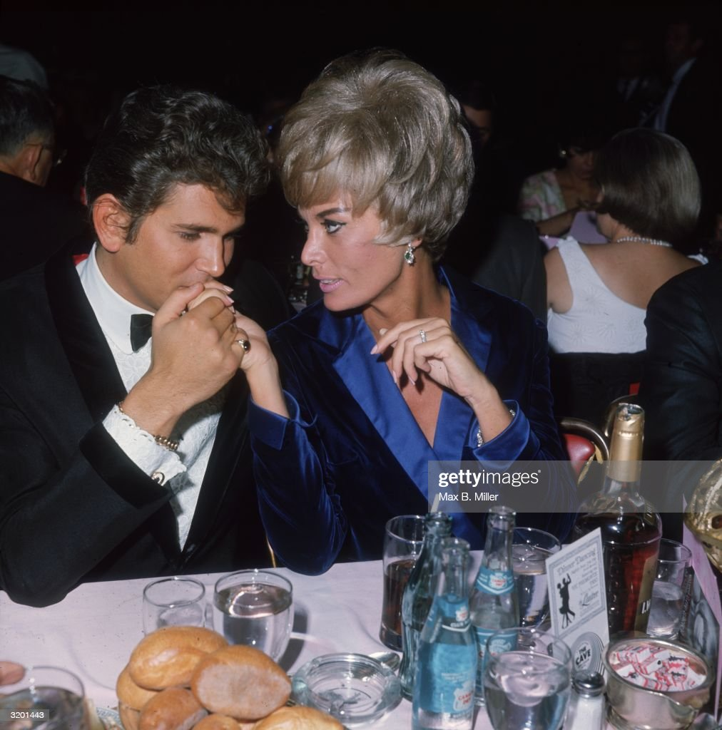 American actor Michael Landon and his wife, Marjorie Lynn Noe, attend the opening night of singer Susan Barrett's performances at the Cocoanut Grove, Hollywood, California. Landon is kissing his wife's hand.