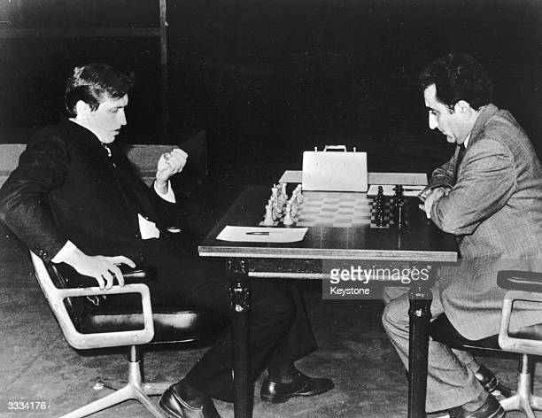 Soviet Georgian chess player Tigran Vartanovich Petrosian playing American Bobby Fischer in the Chess Championships at the Teatro San Martin in...