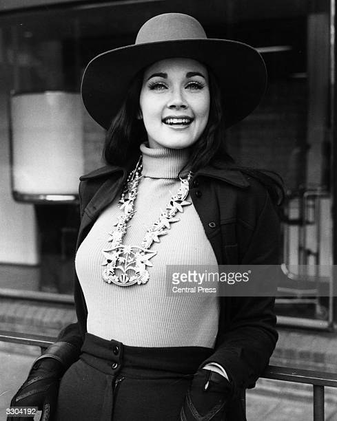 Wearing an Indian necklace Lynda Carter Miss USA arrives at London Airport for the Miss World Contest at the Royal Albert Hall