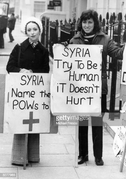 Two Israeli girls Elana Mocatta and Raquel Cohen demonstrate outside the Syrian embassy in London