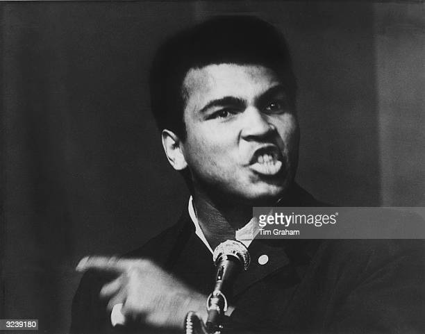 World Heavyweight Champion boxer Muhammad Ali addressing an audience at the New Victoria Theatre in London